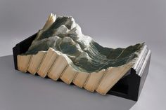 Landscapes and scenes carved from old books. Artist: Guy Laramee.