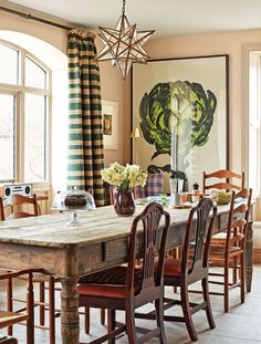 The charming Victorian farmhouse that British designer calls home is everything you'd expect. In the inviting dining area, the Italian table is from and the dining chairs are antiques. The curtains are of a vibran English Farmhouse, English Country Decor, Victorian Farmhouse, Country Farmhouse, Country Style, Rustic Style, Modern Farmhouse, Farmhouse Decor, Dining Area