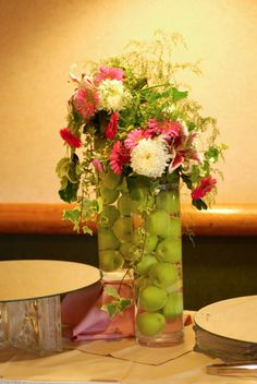 floating apples and flowers centerpiece