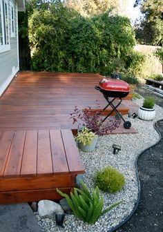Small deck, sunken grill - Tooootally cool with rock garden. Use river stones from my river runs.
