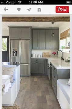 Dream home! Love the wood and colors and counter tops!
