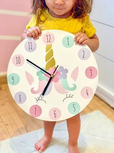 The Ellie Prints kid's wall clocks are uniquely designed and customized to make the perfect addition to any nursery. Our clocks also make a great baby or kid's gift! Your child will love to learn how to tell time! Clock Art, Wall Clocks, Some Love Quotes, Clock For Kids, Unicorn Wall, Gifts For Office, New Things To Learn, Kid Names, Diy Bedroom Decor