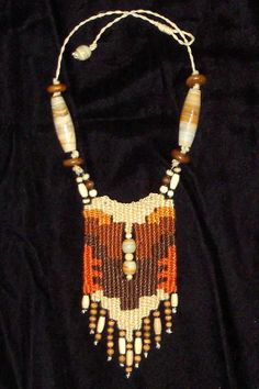 """Desert"" - 2010 - Fixed length choker, stone beads woven in, stairstep design, SOLD. Woven by Terri Scache Harris, theravenscache.shutterfly.com   Hand woven, handwoven, weaving, weave, needleweaving, pin weaving, woven necklace, fashion necklace, wearable art, fashion necklace, fiber art."