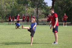 The locals show off their footie skills in Jabiru - with the Melbourne Demons. | Photo by Anja Toms