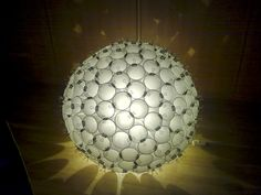 A big illuminated orb made ​​from plastic cups