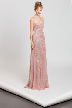 Fully embroidered powder pink strapless lace gown with floral appliques.