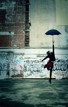 Urban Mary Poppins! ;) love the weightlessness of this pic and graffiti in the bg.