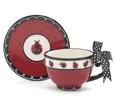 Handwash only/FDA approved. Hand-painted ceramic Ladybug teacup and saucer.  Holds 8 oz. Individually gift boxed.  4 sets of 2.