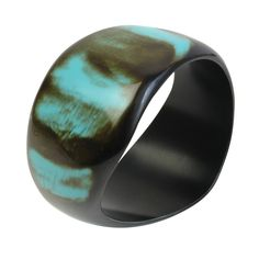 Support fairly paid artisans in India with this modern and stylish bracelet. Featuring mottled hues of turquoise and brown, this reclaimed bone bracelet is handmade by artisans at Noah's Ark in Moradabad, India. Most of the artisans are women who are able to make an income while working directly from home. A Fair Trade fashion statement!
