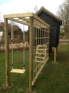 We love how this Miniature Manors play area incorporates a black cladded play house, with a climbing net, #swing and # slide in a small section of the garden. Kids Outdoor Play, Outdoor Play Areas, Kids Play Area, Backyard For Kids, Backyard Projects, Indoor Play, Outdoor Toys, Natural Playground, Backyard Playground