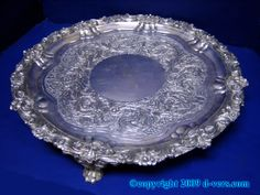 Get a bunch of cheap, antique silver serving trays at thrift stores to use as the base for the centerpieces