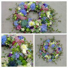 Funeral wreath. Hortensia, dahlia, polyantha Rose, fresia, santini, pineapple flower, papaver, echeveria, malus, eryngium, muelenbeckia.