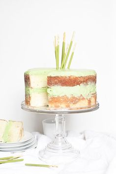 Vanilla cake with matcha frosting and pocky sticks