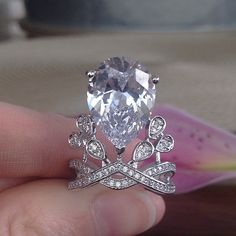 🎉SALE!🎉 NWT The Angela Ring NWT Look and feel like a million bucks without spending it! Comes brand new with boutique tag and free black velvet ring box.  Setting Type: Prong Setting Stones: Clear Zircon crystal Occasion: Bridal, anniversary, wedding, engagement, promise, party, costume, or daily Metal Type: Platinum plated copper Design Style: Angelababy Sizes: 6, 7, 9  *This is a NWT Retail item. Trades will not be considered in this closet. Meredith's Boutique Jewelry Rings