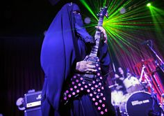 Gisele Marie, a Muslim woman and professional heavy metal musician, plays her electric guitar during a concert in Sao Paulo. Based in Sao Paulo, Marie, age 42, is the granddaughter of German Catholics and converted to Islam several months after her father passed away in 2009. She's been fronting her brothers' heavy metal band, Spectrus, since 2012.