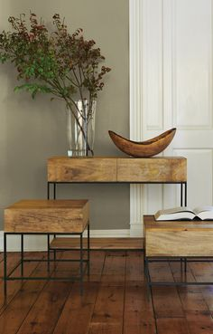 Natural wood and streamlined stems give these tables a modern, earthy feel.