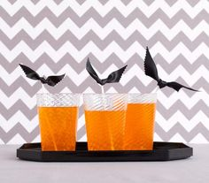 Tie a ribbon around the top of a drink stirrer for an easy DIY bat.