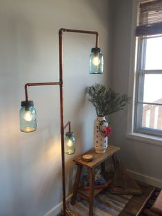 Copper DIY floor lamp with antique blue mason ball jars with the original zinc lids