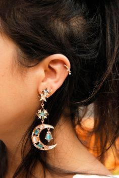 These earrings look like they could tell us our horoscopes.