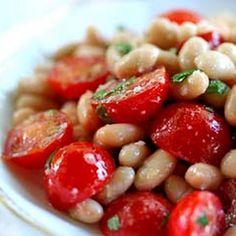 White Beans and Cherry Tomato Salad Recipe Salads with white beans, cherry tomatoes, chopped parsley, extra-virgin olive oil, garlic, fresh rosemary, anchovy fillets, grated parmesan cheese, kosher salt, freshly ground pepper, lemon zest, lemon juice