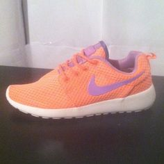 "Women's Nike Roshe Run Brand new! Women's size 7. The colors are orangish pink and purple. Very bright and unique colors. Shoe is wry comfortable and light in weight. Authentic!!! No trades so please don't ask. I will only respond to offer through the ""make an offer"" button. Offers in comment section will be ignored. Thanks :) Nike Shoes Athletic Shoes"