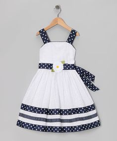 As bright as a daisy, this dress features eyelet fabric with a contrasting tie. Sturdy straps and a zipper mean this piece is ready to join the party in a playful yet pretty fashion.