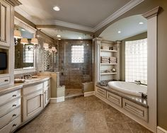 Love the bookcase columns at each end of the tub