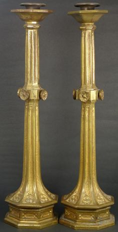 """Pair of antique Tiffany & Company brass candlesticks. Each having an octagonal columnar shape. Marked Tiffany & Co. to bottom of each. Measures 16 3/8"""" height (41.5cm)."""