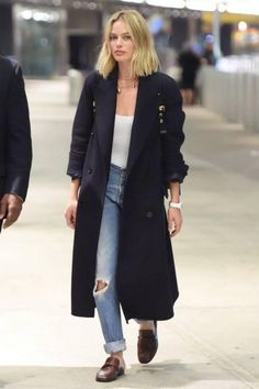Margot Robbie wearing Burberry Medium Rucksack in Technical Nylon and Leather Burgundy Red, Tiffany & Co. City Hardwear Wrap Necklace, Burberry Felted Wool Double-Breasted Coat in Navy and Newbark Melanie Loafers in Cognac