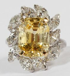 10.79CT YELLOW SAPPHIRE AND 3.00CT DIAMOND RING, SIZE 8 1/2, GIA:Featuring a 10.70ct natural yellow, no heat sapphire surrounded by 10 marquise cut diamonds tot