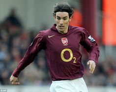 Redcurrant: Robert Pires sporting the shirt that Arsenal wore to say goodbye to Highbury i...