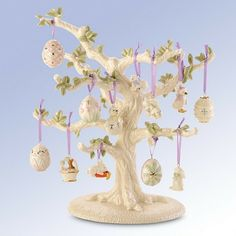 Easter Tree Ornaments www.teeliesfairygarden.com A spectacular sight to brighten your spring. Hatching chicks, adorable bunnies, fully sculptured decorated eggs, ducks, and a gentle lamb are just a few of the 12 removable ornaments that hang from the branches of a sculpted dogwood tree by lavender satin ribbons. Make your Easter decorating more fun this year — and every year. #fairytree