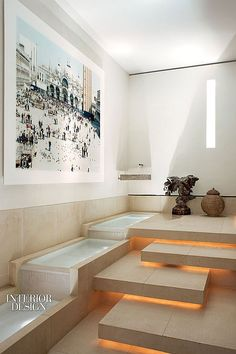 The Art of Living: Paris Triplex by Elliott Barnes | Massimo Vitali's photograph with the spa's limestone-tiled water feature. #design #interiordesign #interiordesignmagazine #architecture #spa #health