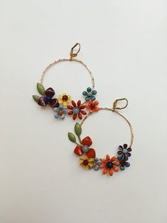 Handmade colorful flower hoops by mignonnehandmade. Great gift for any gardener or those looking for statement jewelry, would pair perfect with any outfit to add a pop of color. Statement Jewelry, Colorful Flowers, Bespoke, Color Pop, Great Gifts, Hoop Earrings, Floral, Handmade, Outfit