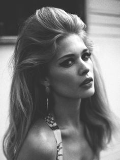 Pulled-Back Bouffant  To get this look, she suggests backcombing the front and back sections of your hair across your crown. Then, pull back the front bang area and pin it in place with bobby pins. Finish with a flexible-hold hairspray, like L'Oreal Paris Elnett Satin Hairspray.