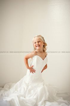 How totally cute is this little girl in her mommy's wedding dress?? These will be a beautiful memory for mom and daughter to cherish for years to come. Can you imagine having a framed one at her ow...