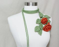 This lovely lariat will add a pop of floral to your outfit. LARGE STRAND, Leaves and vine are made from soft smooth lettuce green yarn, and the large flowers are made from soft light pink yarn. The lariat can be worn in several ways as in photos.  Designed and handmade with great love and care by Sornja. Never worn. Ready to ship from a clean smoke-free environment.