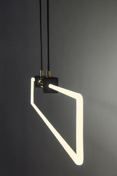 RA Suspension neon dimmable soft warm white by D'Armes Luminaires Canada. photo credits - Jean-Sébastien Senécal.