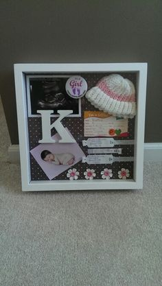 Finally a shadow box that looks organized and like everything has its place. Might do this for Baby Boy.
