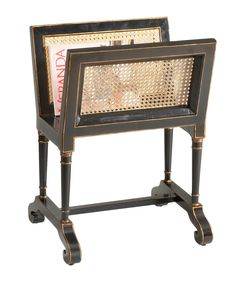 This traditional magazine rack is the perfect piece to store your favorite glossy readers. The black wood is accented in a rustic gold trim throughout the sides, which looks great with the cane sides.