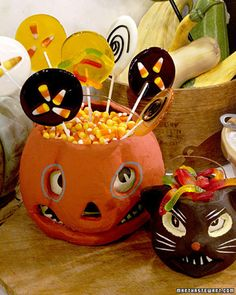 Halloween Lollipops | Martha Stewart Living - Making Halloween lollipops is a fun way to gear up for the holiday, and when you're done, you'll have treats to hand out to the goblins at the door or as party favors.
