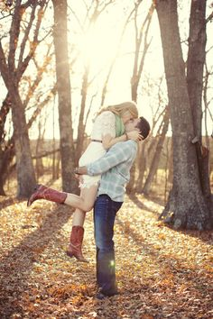 A little lift and a little kiss in the woods in this Texas ranch engagement session