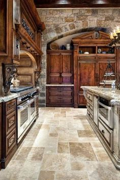 The wood, granite, stone and flooring are just right! Nice Kitchen, Awesome Kitchen, Stone Kitchen, Kitchen Near Entry, Armoire In Kitchen, Grand Kitchen, Kitchen Colors, Cozy Kitchen, Kitchen Wood