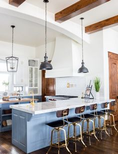 Mountain home with farmhouse charm. Love the island color. Design by Becki Owens