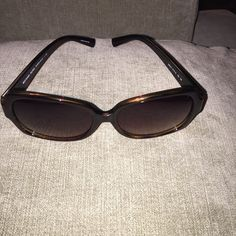 Michael Kors Sunglasses New with plastic still covering the MK on each side of the glasses. Comes in Michael Kors glasses case. Michael Kors Accessories Sunglasses