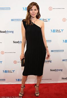 Sophisticated: Michelle Monaghan opted for a simple asymmetric shift dress for the event...
