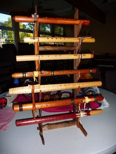 Redwood Native American Flute rack for seven flute display. $100.00, via Etsy. It's a proven fact: if your flutes are easily available to pick up, you will, and that's how you improve your playing.