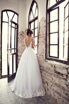 lace and tulle wedding dress with an open back For more bridal inspiration visit us at Lola Bee and me