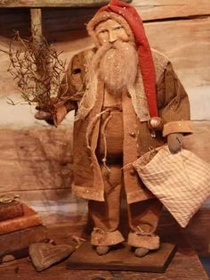 Folk Art Santa with toy sack and switches.