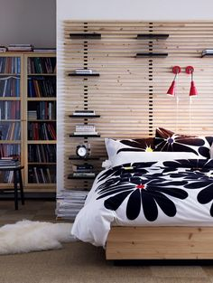 Large wooden headbord from Ikea called Mandal. The headboard is in solid birch with adjustable shelves and can be mounted on the wall.